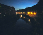Tiber River bridge at night