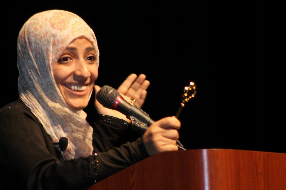 Karman, the first Arab woman to win the Novel Prize, holds a key to the city from Dearborn's Mayor. (Tina Nelson)