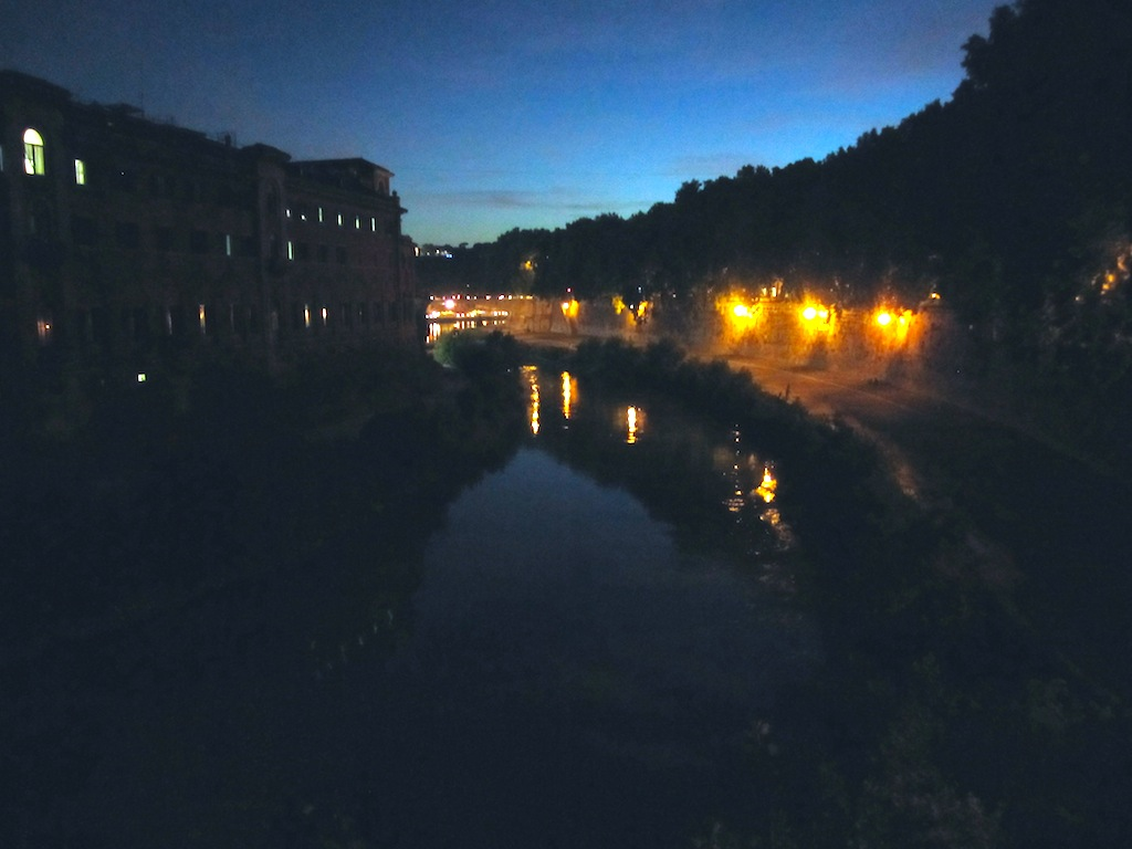 At night, people walk their dogs, eat gelato, and stroll hand in hand down the Tiber River. (Elizabeth Bastian / MJ)