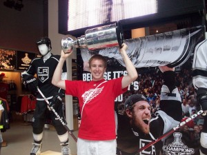 Raising a mini Stanley Cup in the NHL Store