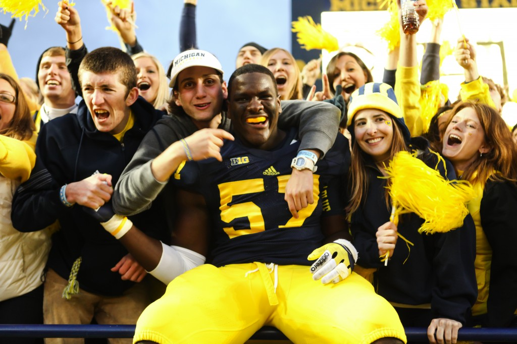 Michigan Wolverine Frank Clark celebrates win against MSU (Credit: Tommy Alexander / MJ)