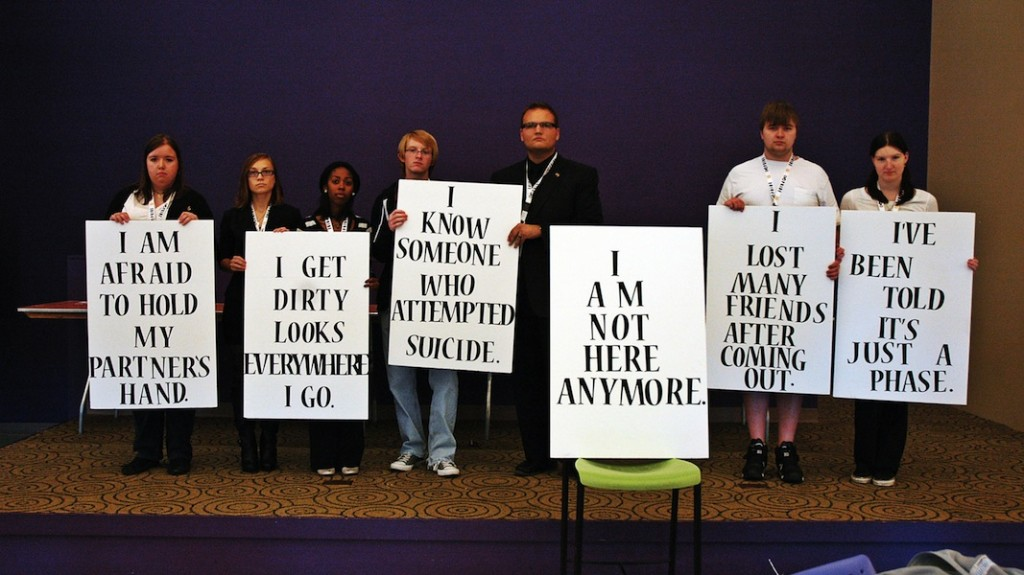"""According to Anthony Wagner, chair of PRIDE, about 17 volunteers held signs around the University Center stating phrases such as """"I know someone who committed suicide"""" and """"I am not here anymore."""" (Photo Credit: Troy A. Blevins / MJ)"""