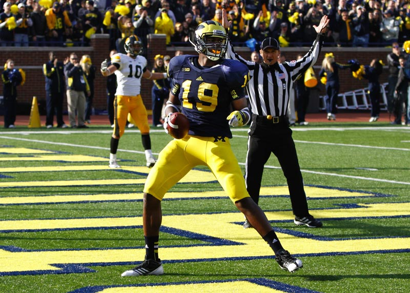 Devin Funchess celebrates a touchdown against Iowa in 2012. (MJ file photo).