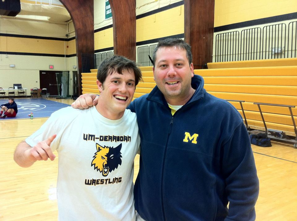 Dan Loyd, left with Head Coach Grant MacKenzie. Loyd has been wrestling ever since he can remember, and is a current staff writer for the Michigan Journal (Courtesy of UM-Dearborn Wrestling Club)