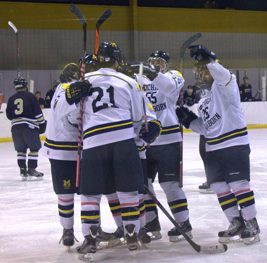 The Wolverines celebrate a goal against Pittsburgh. (Brianna Frisch/MJ)