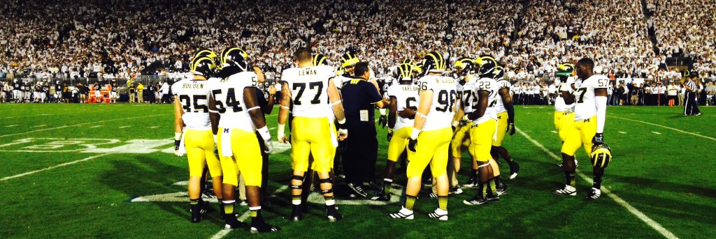 Michigan's defense huddles up during a timeout in the first overtime. (Ricky Lindsay/MJ)