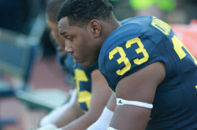 Freshman defensive end and Ohio native Taco Charlton sits in disappointment after the Wolverines loss to Ohio State. (Amanda Gosline/MJ)