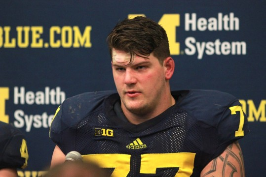 Fifth-year senior Taylor Lewan at a post-game press conference during the 2013 Michigan Football season. (Amanda Gosline/MJ)