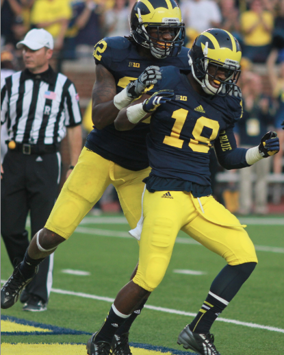 Blake Countess celebrates an interception return for a touchdown against Minnesota. (Amanda Gosline/MJ)
