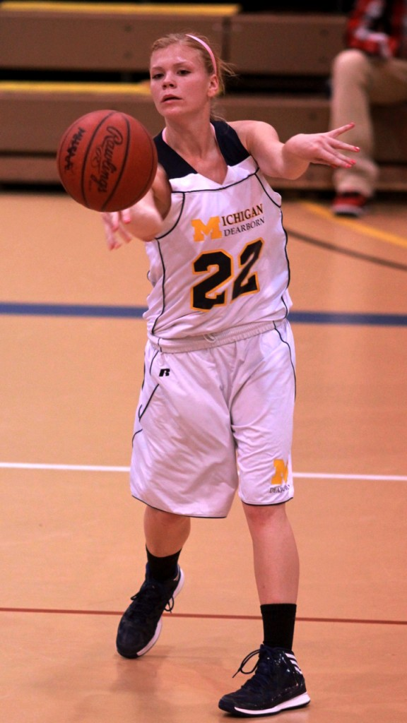 Courtney Teets makes a pass during the Lady Wolverines season opener against Rochester. (Amanda Gosline/MJ)