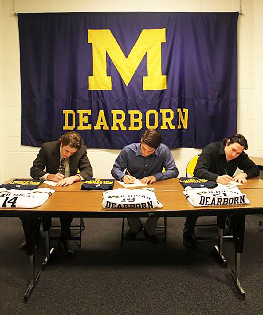 Donnie Nagle, Collin Flynn, and Jeff McFarland sign their letters of intent to play hockey at the University of Michigan-Dearborn next fall. (Brianna Frisch/MJ)