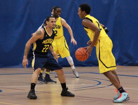 The UM-Dearborn men's basketball team dons their new uniforms for this season during midnight madness. (Amanda Gosline/MJ)