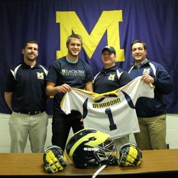 Jason Watts, Matt Rosteck, Mike Wagner, and Patrick Riley pose after the UM-Dearborn lacrosse team signed its first ever player in program history. (Brianna Frisch/MJ)