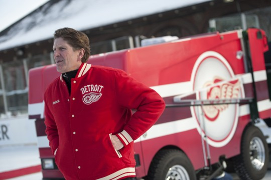 Detroit Red Wings' coach Mike Babcock stands in front of the new zamboni at Clark Park during the team's outdoor practice last season. Photo courtesy of Detroit News.