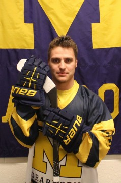 Jase Paciocco poses in UM-Dearborn's 2014 outdoor game jersey. (Brianna Frisch/MJ).