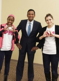 Roop Raj poses with UM-Dearborn students during his presentation on Thursday.