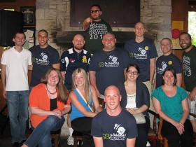 Volunteers from last year's fundraiser proudly show off their new bald heads.