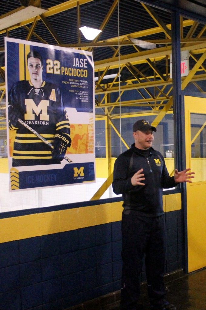 UM-Dearborn hockey coach Chris Haltinner speaks to recruits and their families during a signing day. (Brianna Frisch/MJ).