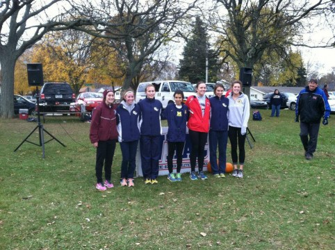 Julia Kassem, center, poses for a photograph at the NAIA National Championships last fall. Photo courtesy of Julia Kassem.