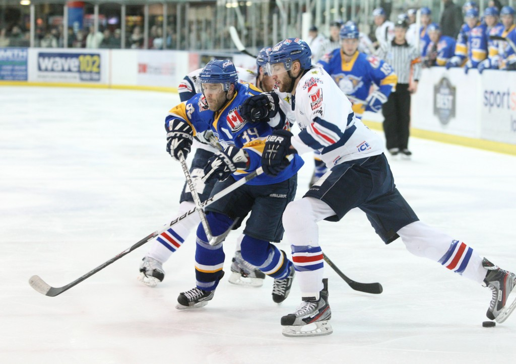 Chris Zarb battles on defense during his time with the Dundee Stars in Scotland. (Photo courtesy of slapshotscotland.com.)