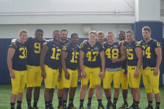 Michigan's linebackers pose for a photo during media day. (Rebecca Gallagher/MJ).
