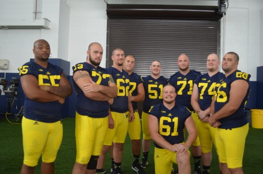 Michigan's offensive line poses for a photo during media day. (Rebecca Gallagher/MJ).