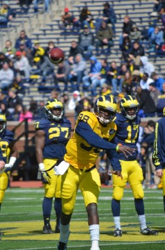 Devin Gardner tosses a football during Michigan's spring game in April. (Rebecca Gallagher/MJ).