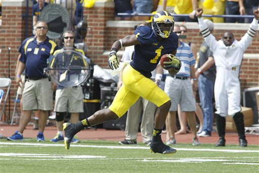 Devin Funchess dons the prestigious No. 1 jersey for the first time in Michigan's season-opening rout over Appalachian State. (AP Photo).
