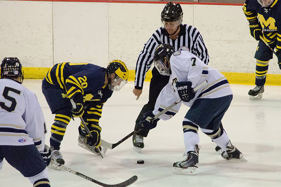 Jeff McFarland readies for a face-off against Pittsburgh.  (Photo courtesy of Pitt hockey).