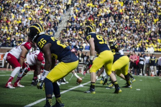 Michigan's defense awaits the snap from Miami. (Rebecca Gallagher/MJ)