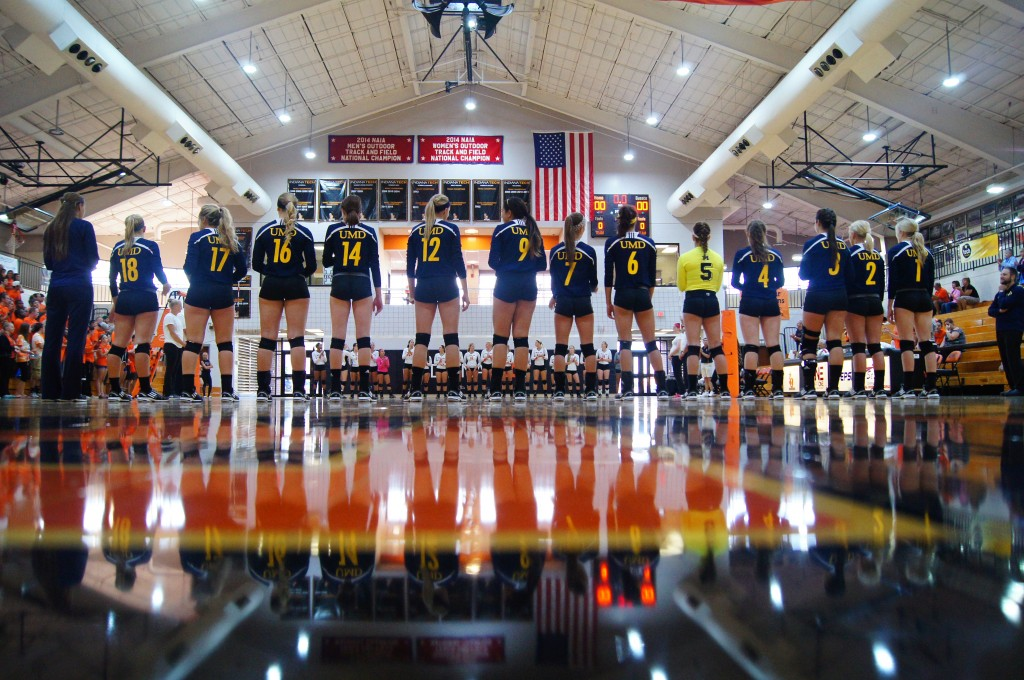The UM-Dearborn volleyball team in a pre-game lineup before its contest with Indiana Tech. (Photo courtesy of Ferrell Mayes).