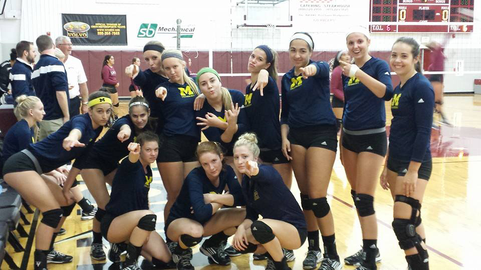 The University of Michigan-Dearborn volleyball team poses before its tri-match vs. Northwestern Ohio and Lindsey Wilson on Sept. 27, 2014. (Photo courtesy of UM-Dearborn volleyball)