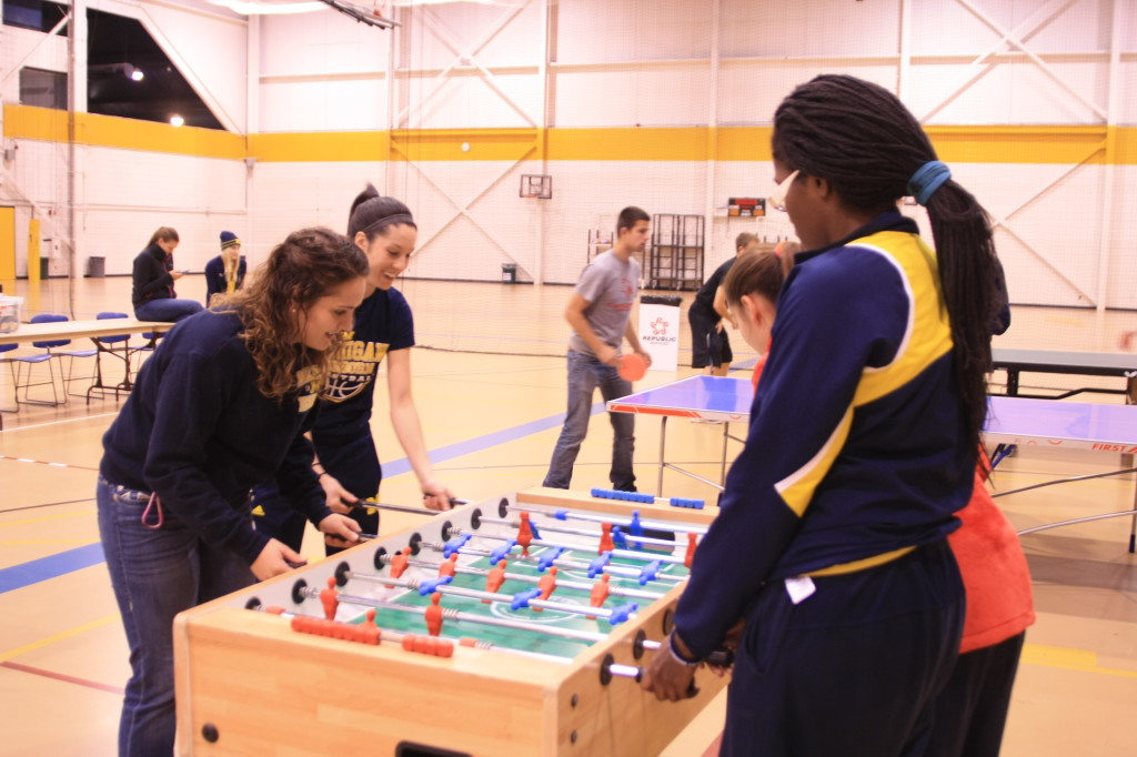 Female Students show their skills at foosball at Victors Fun Night