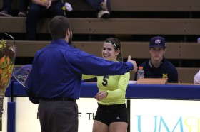 Becca Carley prepares to hug UM-Dearborn volleyball coach Eric Stark on senior night. (Ricky Lindsay/MJ)
