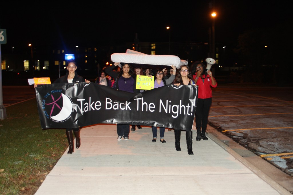 Attendants of Take Back The Night protest against violence and abuse against women  with yelling chants and marching around UMD campus