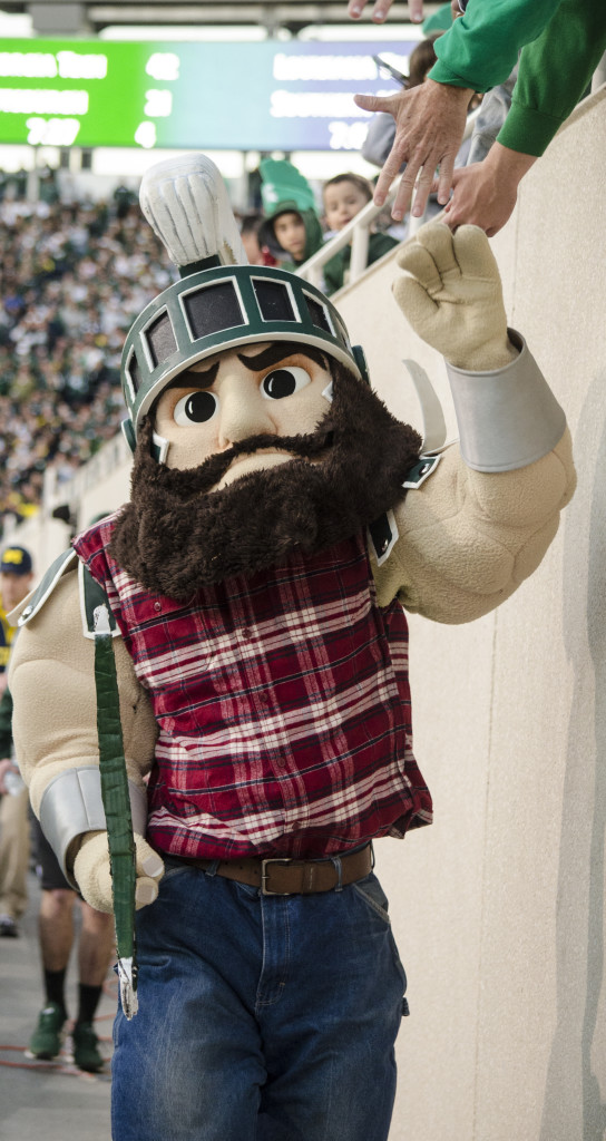Sparty high-fives fans while dressed up as Paul Bunyan. The winner between Michigan-Michigan State receives the Paul Bunyan Trophy. (Rebecca Gallagher/MJ)