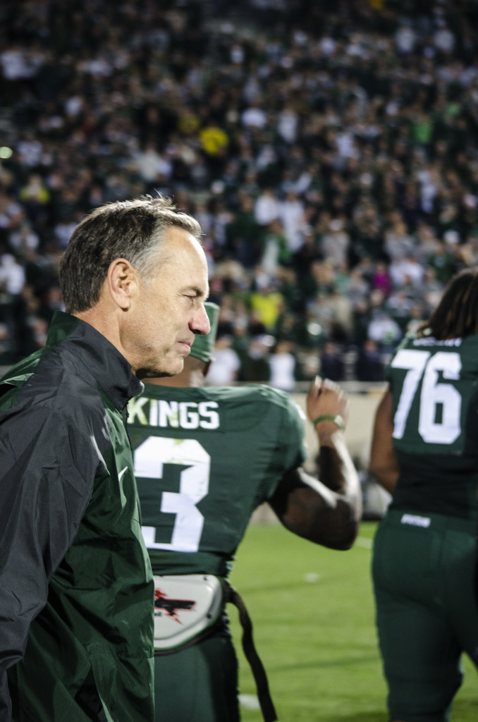 Mark Dantonio walks off the field during Michigan State's 35-11 win over Michigan Oct. 25, 2014. (Rebecca Gallagher/MJ)