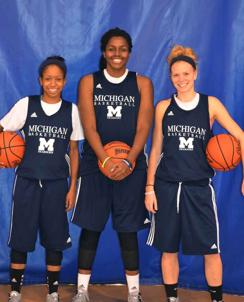 Seniors Andrea Collins, Jalissa Williams, Courtney Teets pose before basketball practice. (Rebecca Gallagher/MJ)