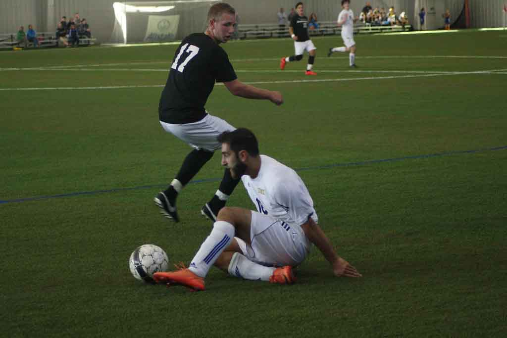 Jad Hmadeh slides during UM-Dearborn's 4-1 loss to Aquinas College. (Photo courtesy of Samantha Elliott).