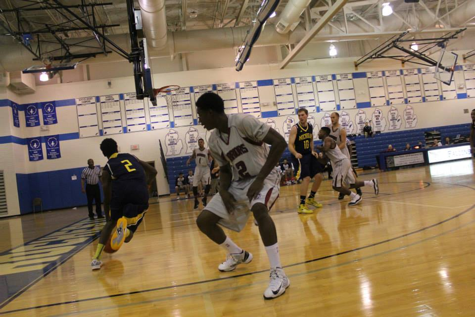 Jamiel Strickland drives the lane in UM-Dearborn's season-opener against Rochester College. (Photo courtesy of UM-Dearborn men's basketball).