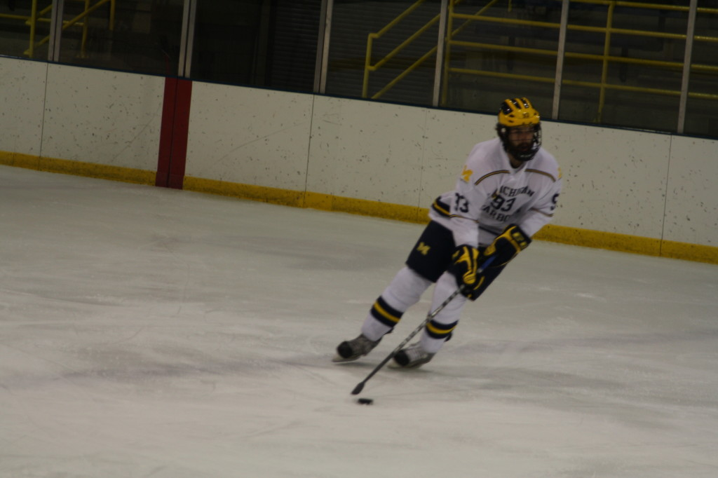 Jeremy Klotz controls the puck during UM-Dearborn's  5-4 overtime upset over No. 3 Adrian. (Craig Henderson/MJ)