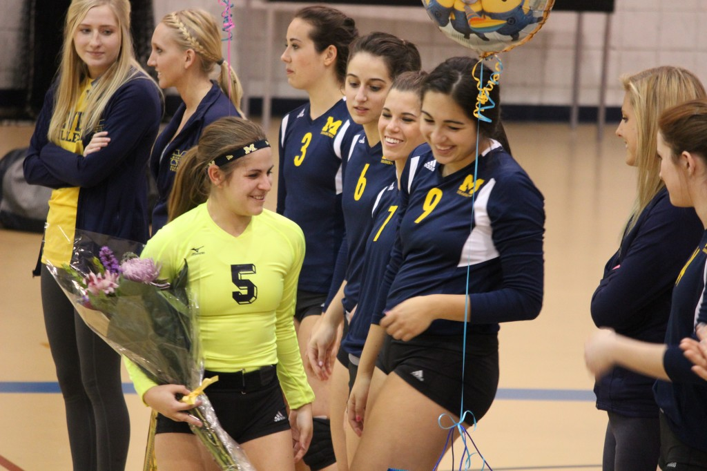 Becca Carley (5) shares a moment with Megan Ynclan (9) during senior night. (Ricky Lindsay/MJ)