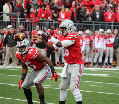J.T. Barrett receives the snap during the first quarter in Michigan-Ohio State. (Ricky Lindsay/MJ)