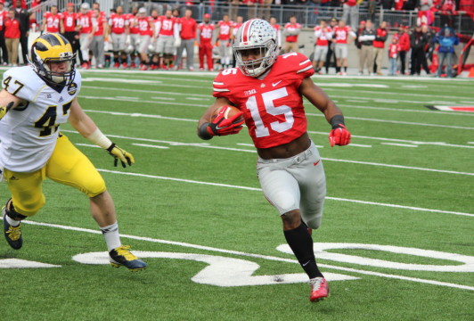 Jake Ryan gives chase as Ezekiel Elliott bursts down the field following a first-quarter carry. (Ricky Lindsay/MJ)