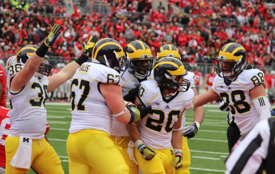 Drake Johnson celebrates his first touchdown with teammates. (Ricky Lindsay/MJ)