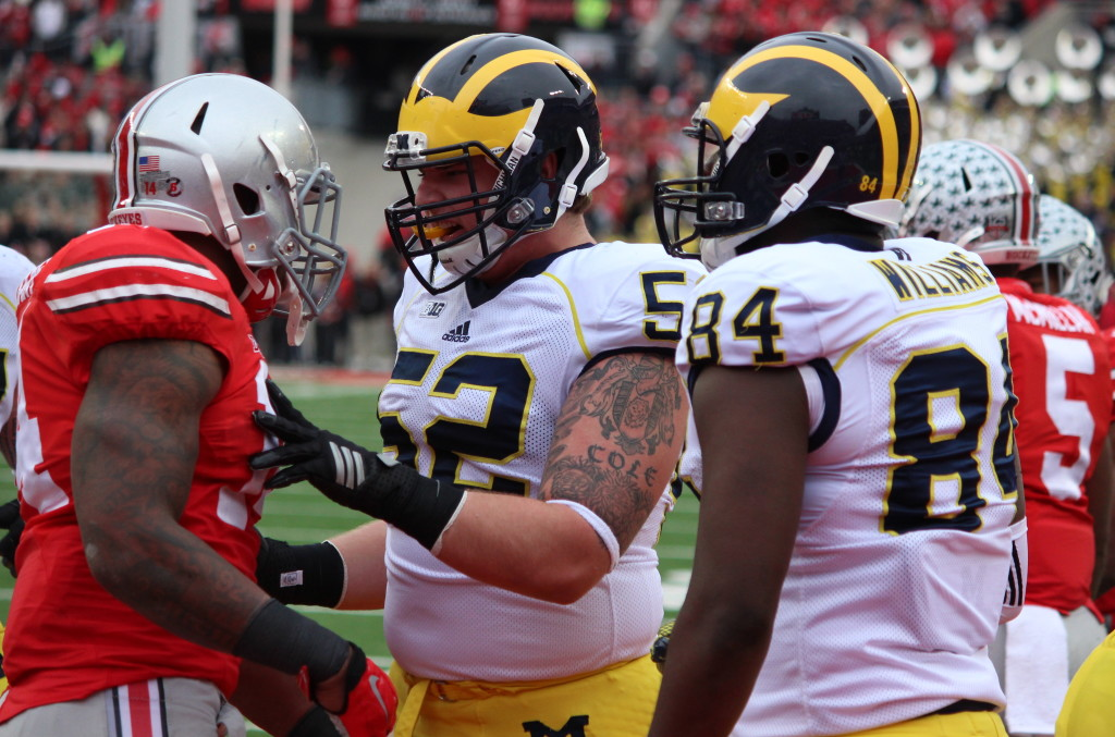 Mason Cole and an Ohio State player exchange words after Drake Johnson's second touchdown of the game between the Wolverines and Buckeyes on Nov. 29. (Ricky Lindsay/MJ)