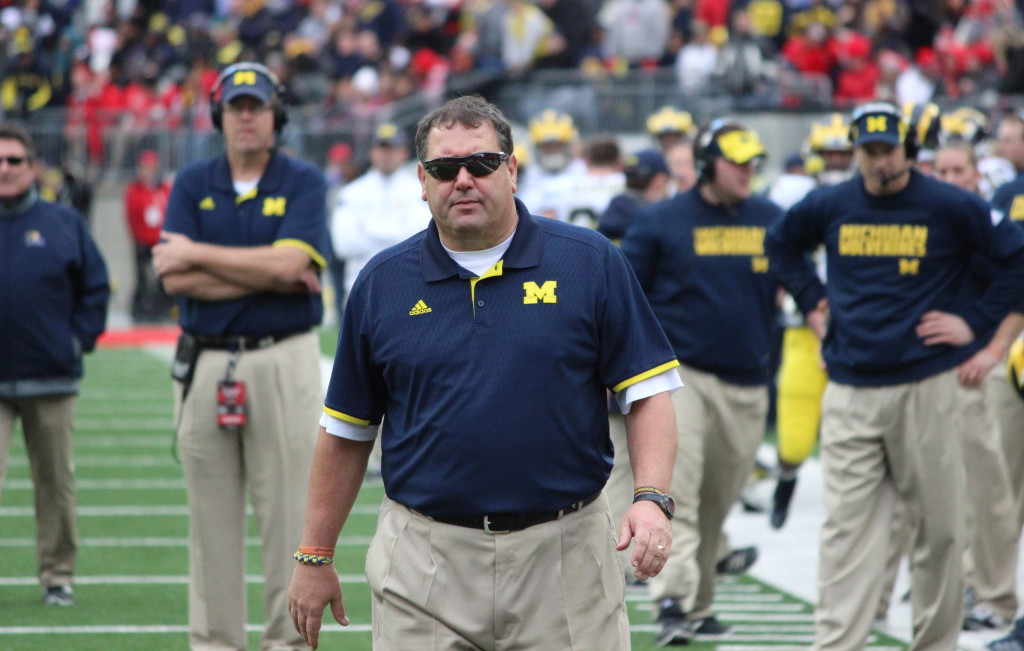 Brady Hoke walks over to an injured Drake Johnson during the third quarter of Michigan's 42-28 loss to Ohio State on Nov. 29, 2014. (Ricky Lindsay/MJ)