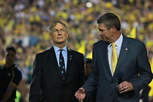 Dave Brandon, right, speaks with Mark Harmon, left, during Michigan's game with Notre Dame in 2013. Michigan made the number of Tom Harmon, Mark's father, a legacy jersey. (Amanda Gosline/MJ)