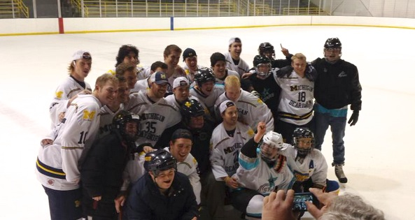 UM-Dearborn hockey poses with members of the MORC Stars Hockey team and JoBrighton Skills Center. (Erick Lehman/MJ)