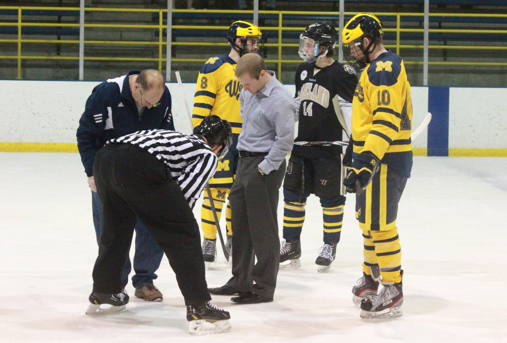 Matt Beaudry (center) surveys the Fieldhouse' ice rink during UM-Dearborn's series opener vs. Oakland Jan. 23, 2015. The game was cancelled after 33 minutes of game time and an hour delay due to thin ice. (Ricky Lindsay/MJ)